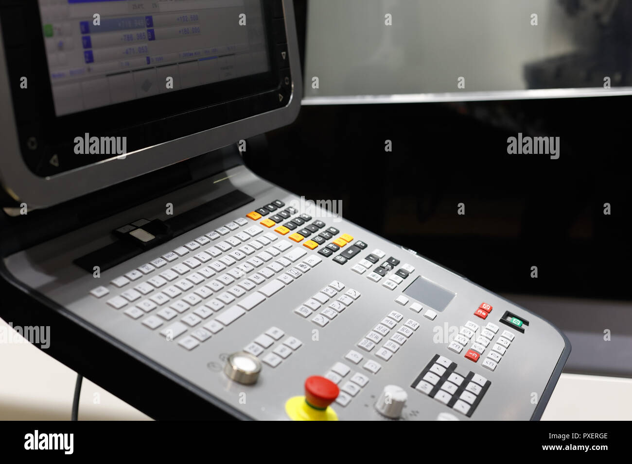 Control panel of 5-axis CNC machining center. Selective focus. - Stock Image