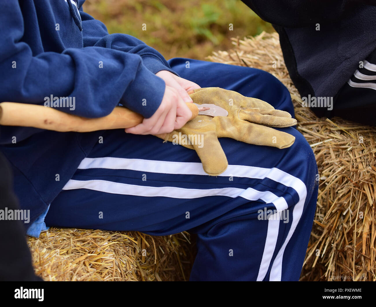 Young child practicing making an arrow head - Stock Image