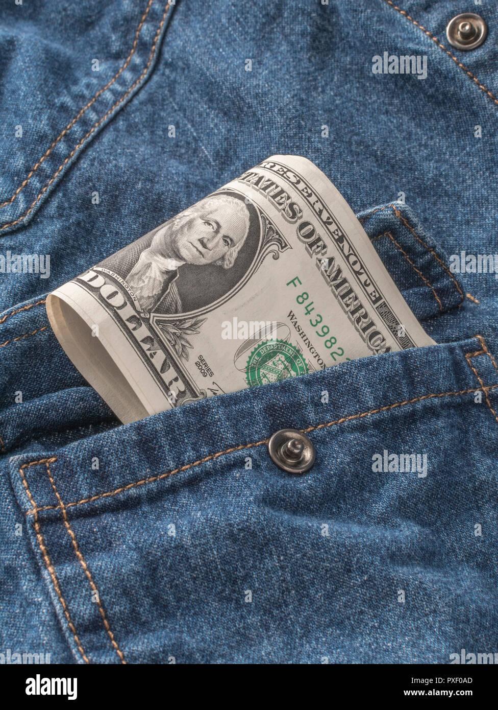 US / American 1 Dollar bills in pocket - metaphor for 'Money in Your Pocket', U.S. earnings. - Stock Image