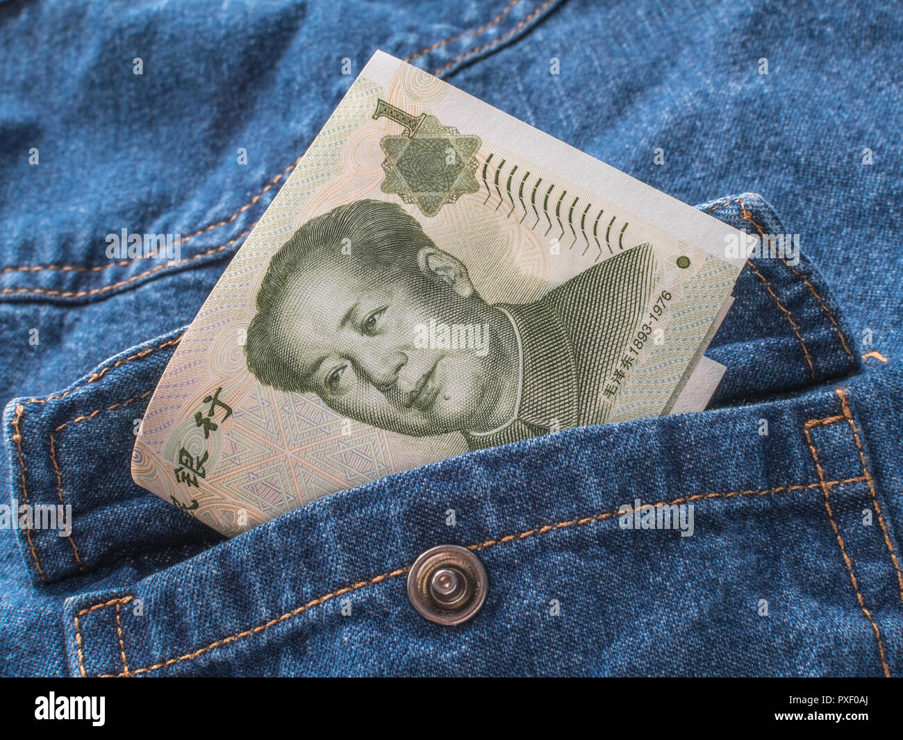Chinese Yuan / Renminbi banknotes with pocket - metaphor for personal earnings, Chinese wages, wage levels. - Stock Image