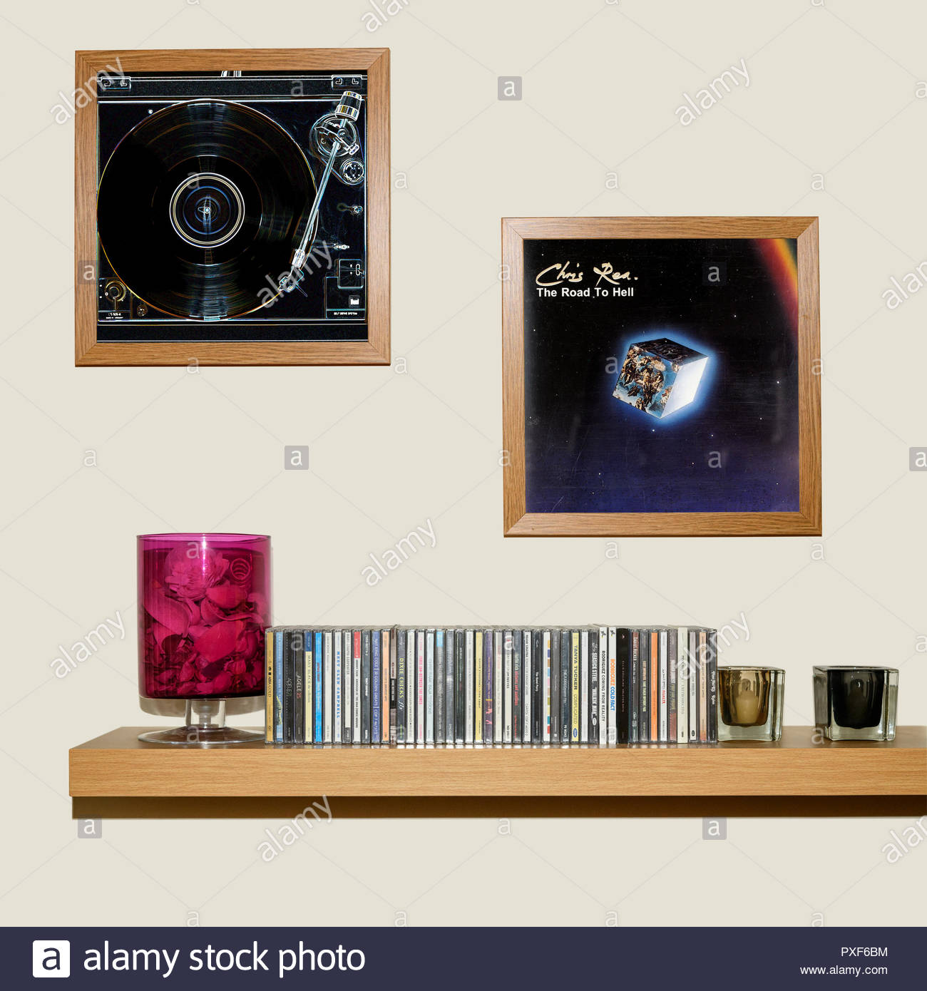 CD Collection and framed Chris Rea 1989 album The Road To Hell, England - Stock Image