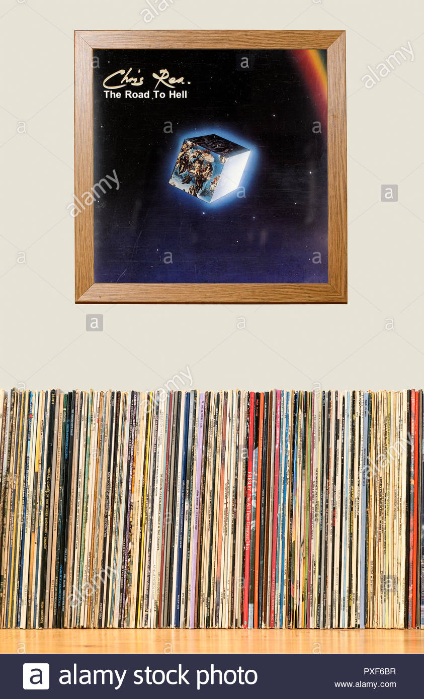 LP Collection and framed Chris Rea 1989 album The Road To Hell, England - Stock Image