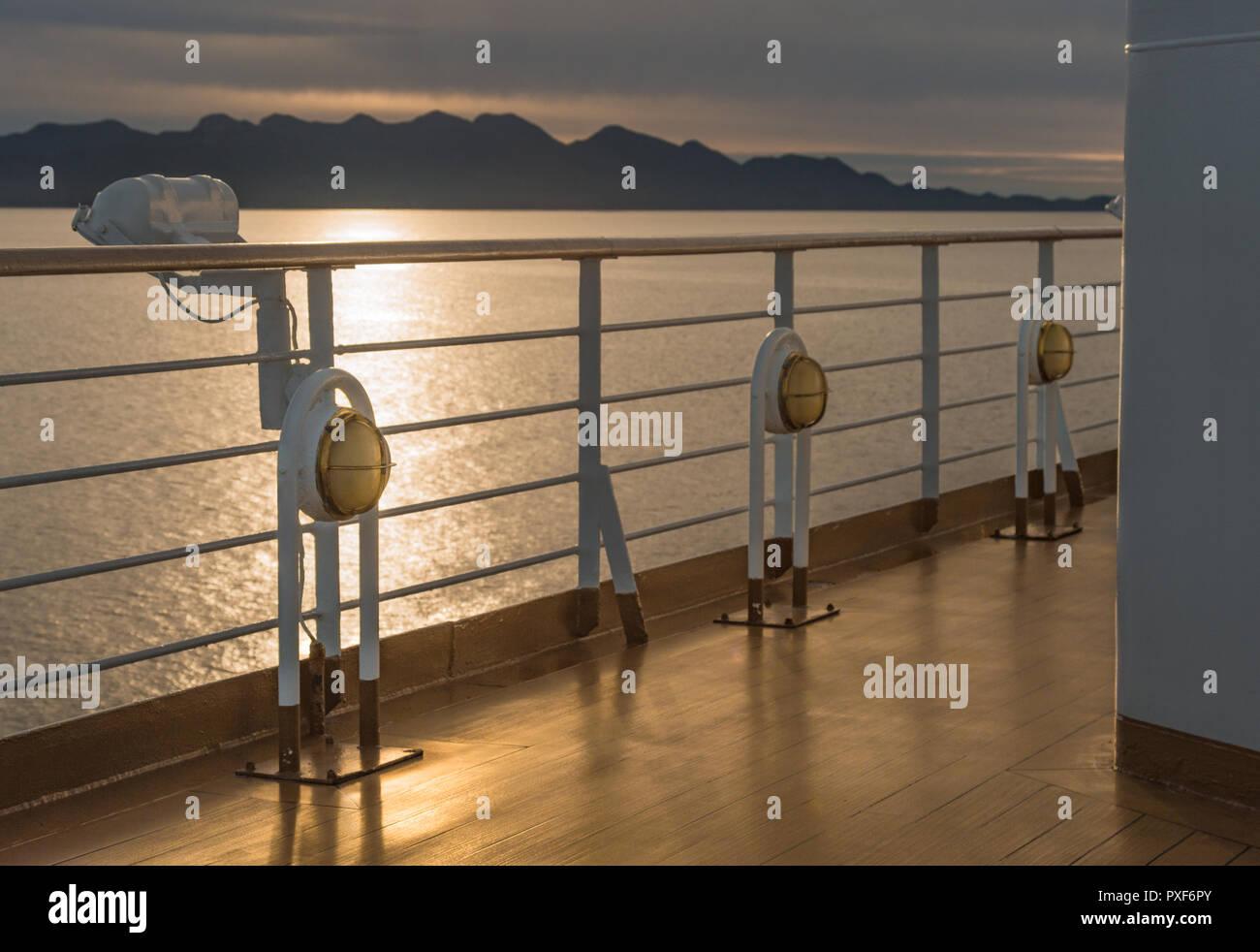 Three Nautical cruise ship deck walkway metal and brass exterior marine light fixtures. - Stock Image