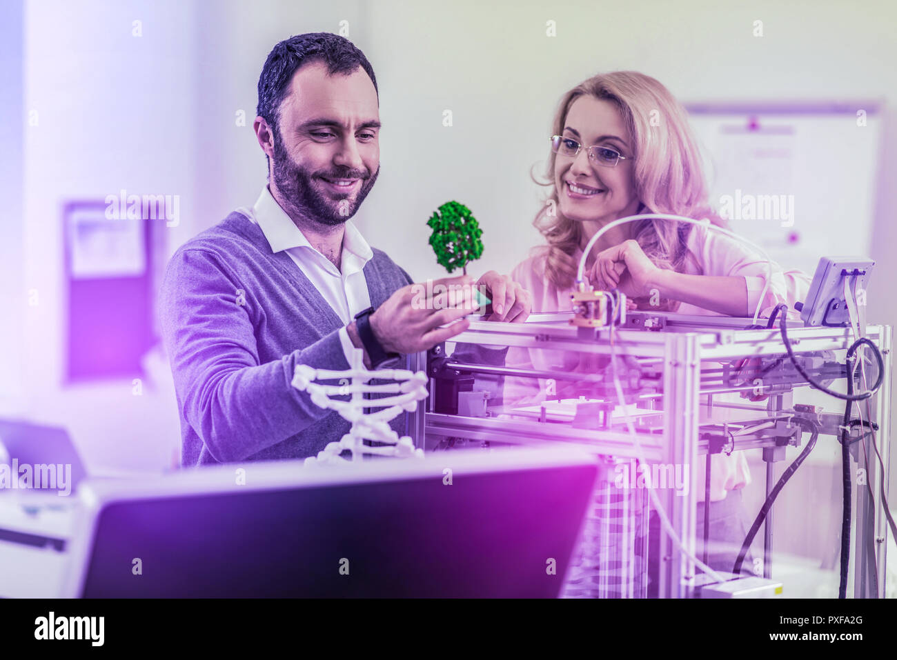Couple of beaming architectures working on their new project of smart green city - Stock Image