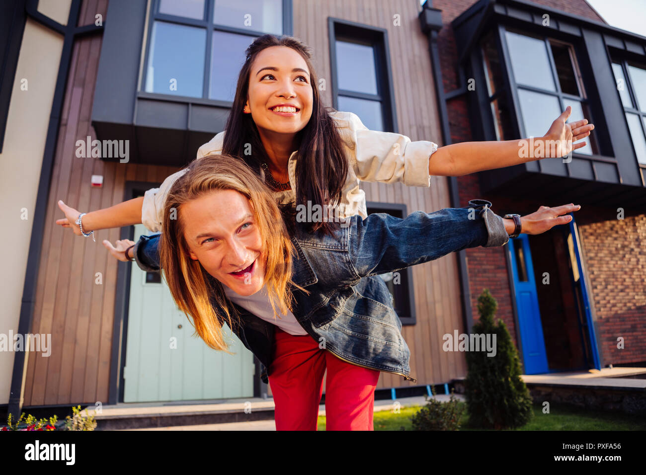 Positive nice couple starting to live together - Stock Image