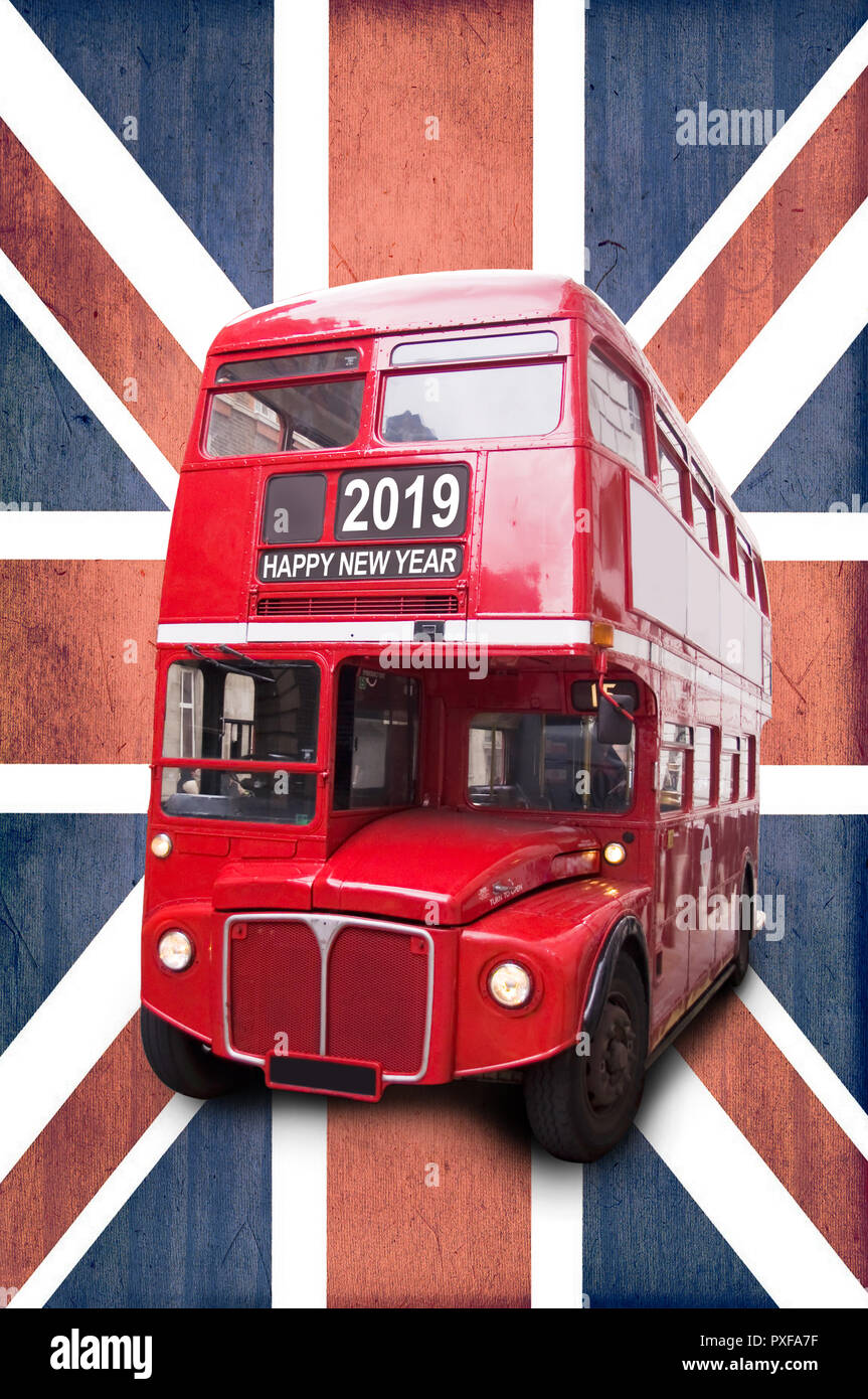 Happy new year 2019 written on a London vintage red bus, Union Jack background - Stock Image