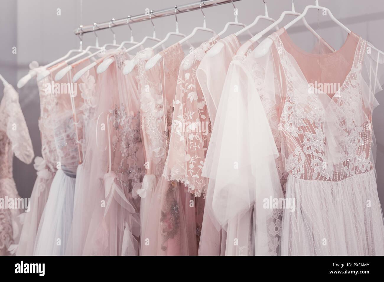 06c0bdb97b Beautiful wedding dresses hanging on hangers in the shop Stock Photo ...