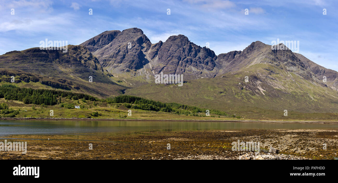 Panoramic view of Bla Bheinn and Cuillin Mountains on the Isle of Skye with Loch Slapin in the foreground, Scotland, UK - Stock Image