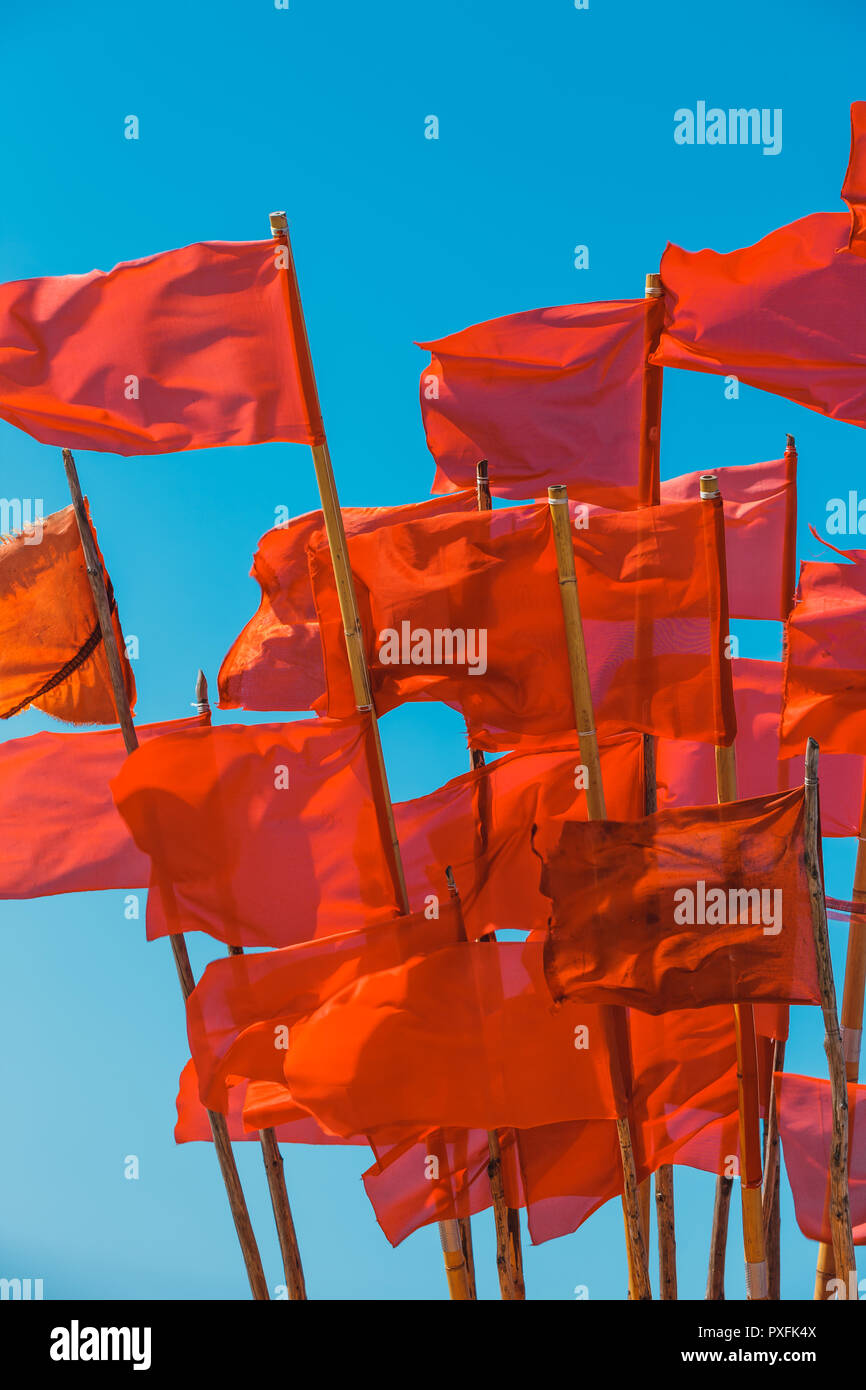 Fishing boat and red flags flying in wind - Stock Image