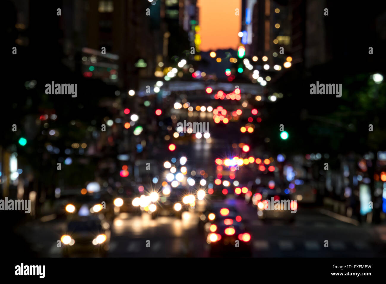 Abstract blurred lights of a busy night street scene in Manhattan New York City - Stock Image