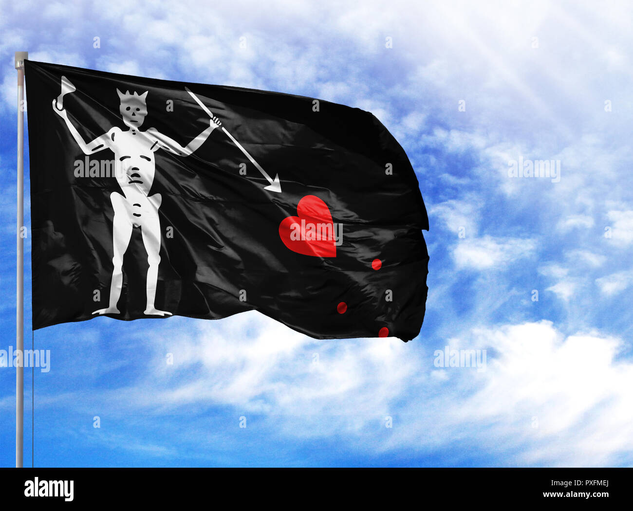 National flag of Blackbeard Pirate on a flagpole in front of blue sky. Stock Photo