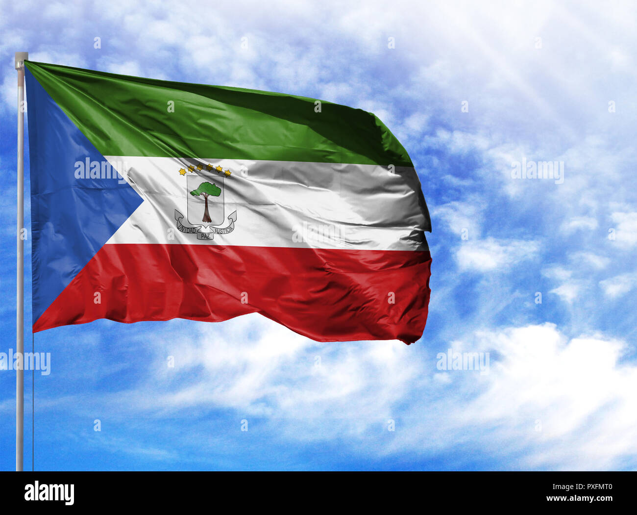 National Flag Of Equatorial Guinea On A Flagpole In Front Of