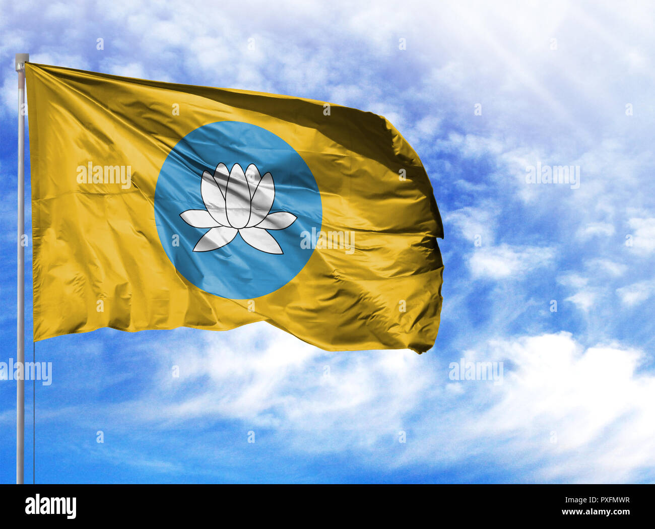 National flag of Kalmykia on a flagpole in front of blue sky. - Stock Image