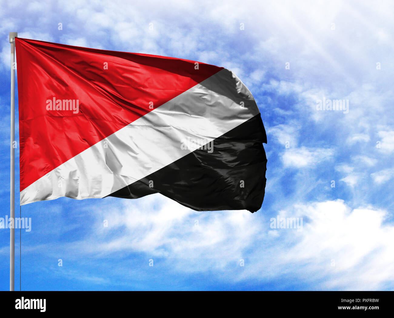 National flag of Sealand,Principality of on a flagpole in front of blue sky. - Stock Image