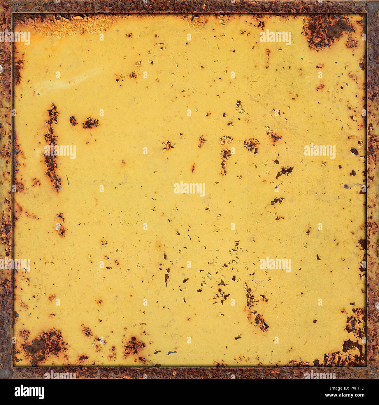 Old Damaged and Weathered Metal or Steel Surfaces Painted by Yellow Color as Industrial Background - Stock Image