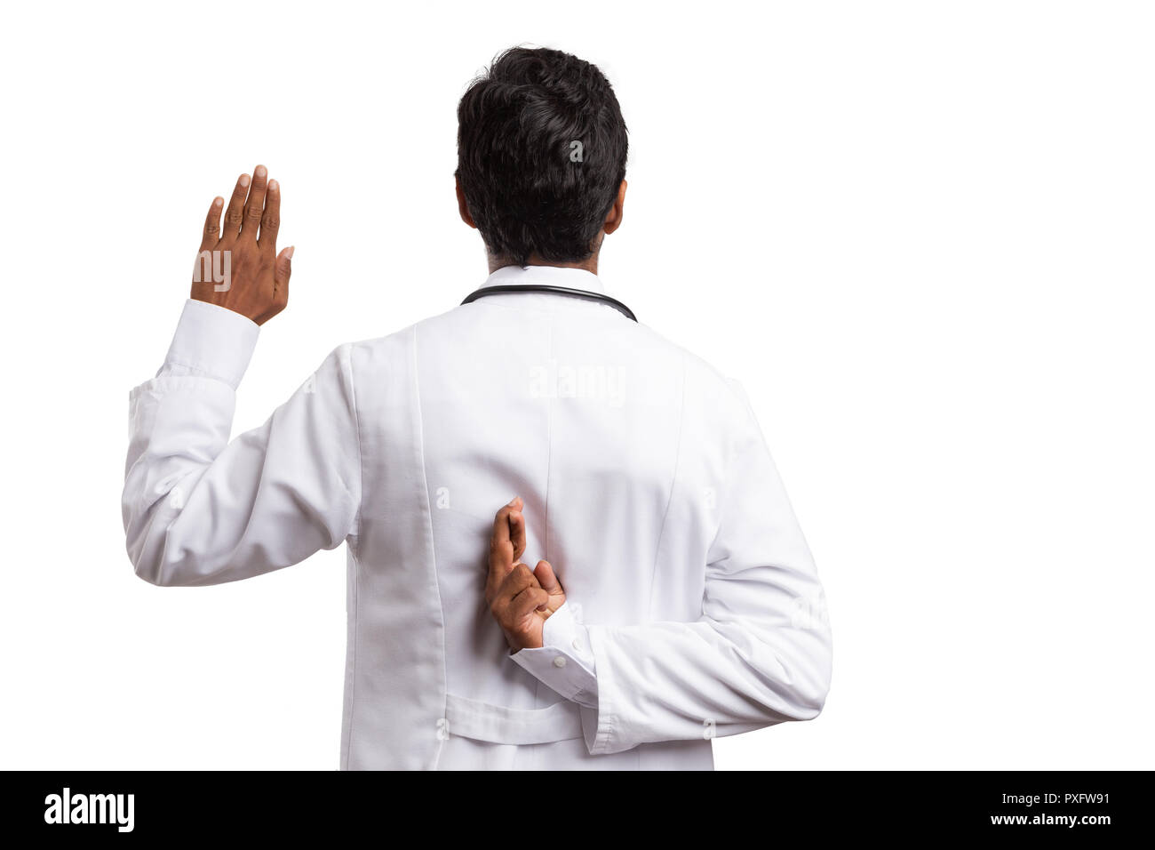 Fake oath made by indian doctor with fingers crossed behind back and raised palm isolated on white background - Stock Image