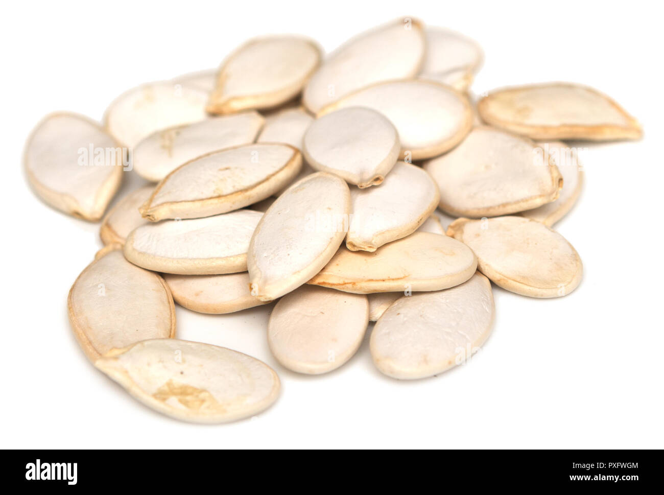 Pumpkin seeds isolated on white background Stock Photo