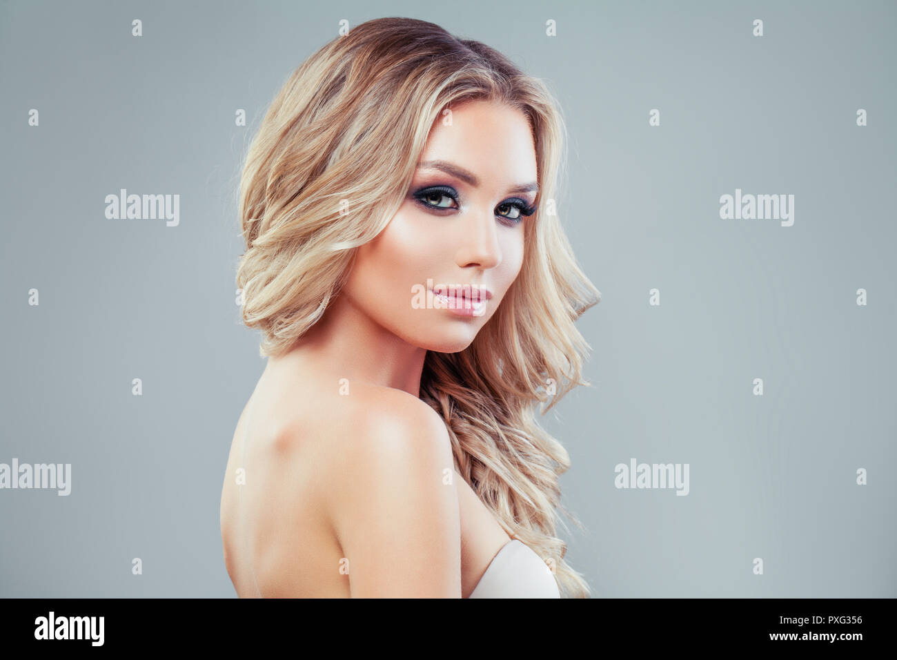 Beautiful Woman With Long Blonde Wavy Hair And Makeup On Banner Background Stock Photo Alamy