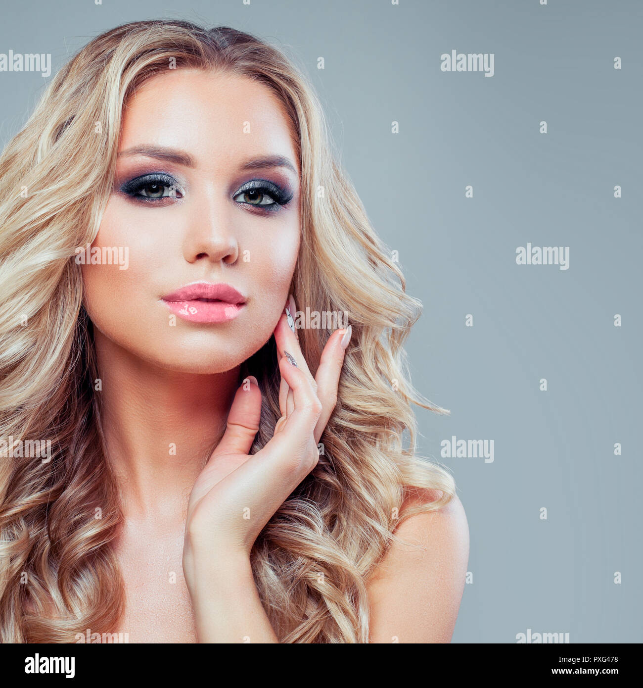 Beautiful Blonde Woman With Makeup And Wavy Hairstyle Stock