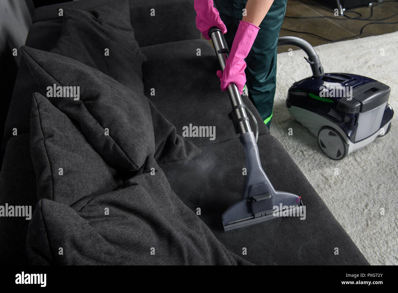 Cropped Shot Of Person Cleaning Sofa With Vacuum Cleaner Upholstery