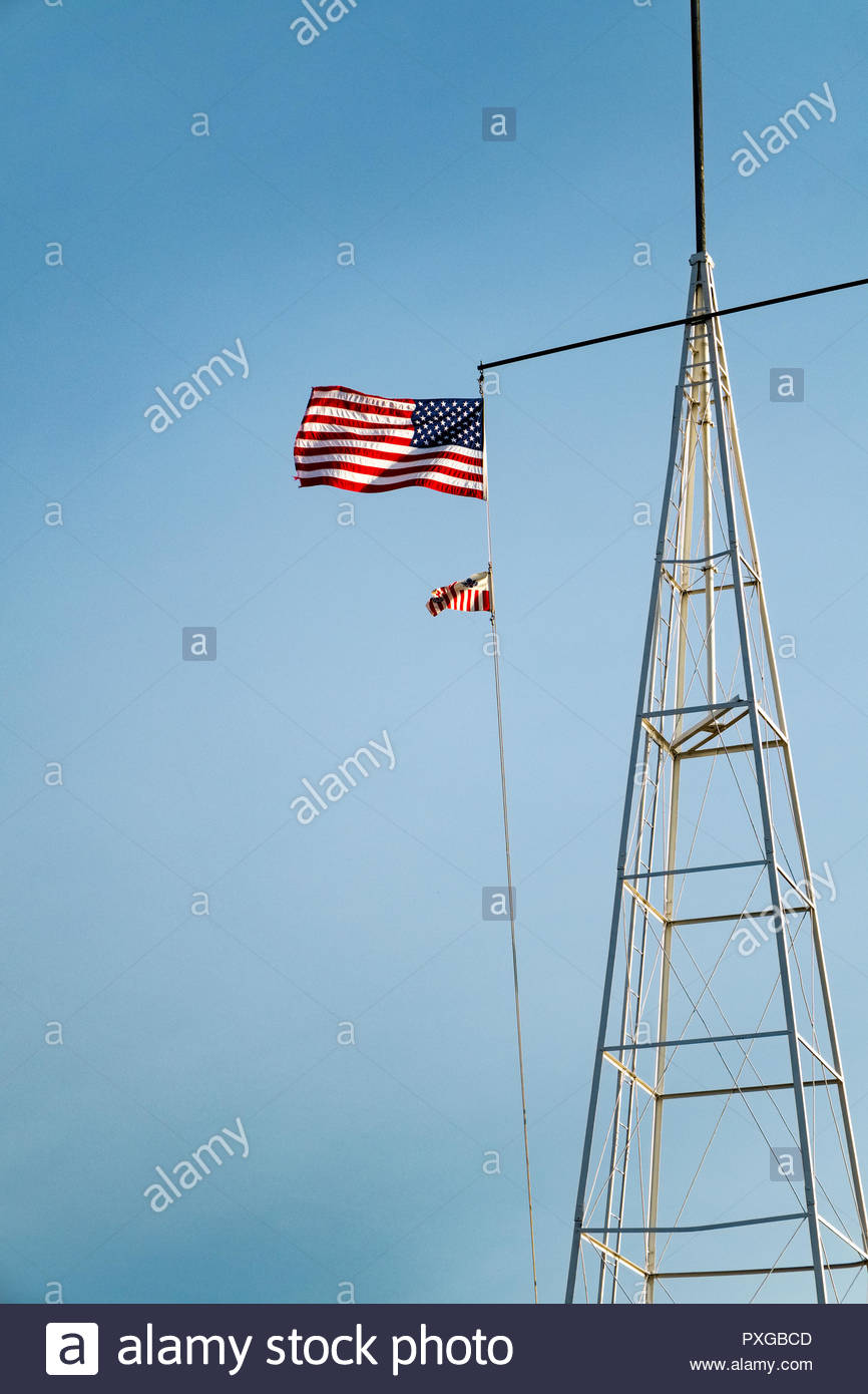 American and U.S. Coast Guard flags fly on radio tower of Coast Guard Station in Grand Marais, Minnesota, USA. Stock Photo