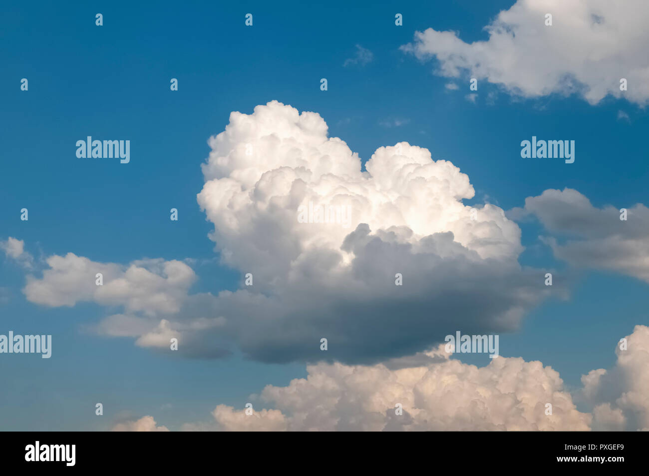 Beautiful cumulus cloudscape on a blue sky background. Photographed in Tyrol, Austria Stock Photo