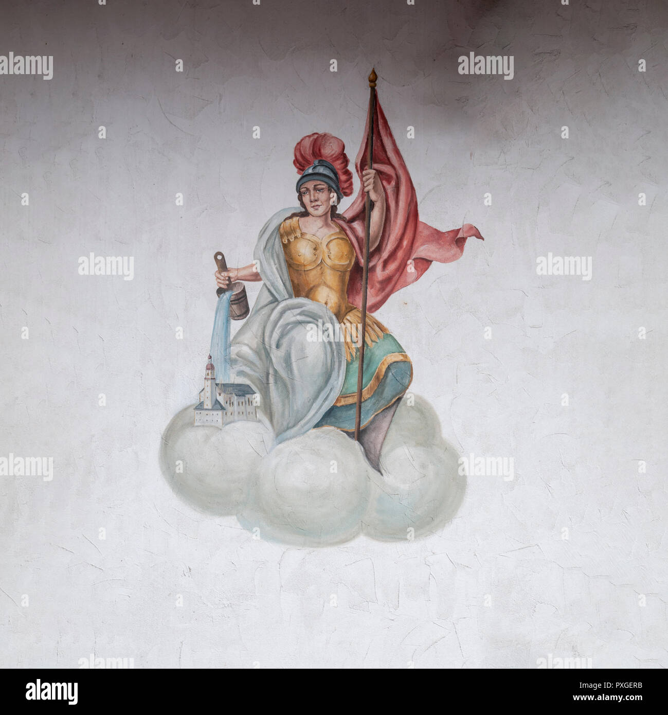 Mural of Athena, goddess of wisdom, handicraft, and warfare, a female deity in body armour, helmet and holding a banner watering a small town. From Ty - Stock Image