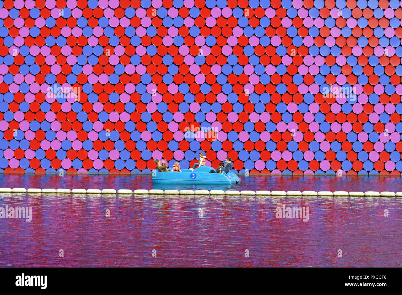 Family boating beside the London Mastaba in the Serpentine, Hyde Park, London, United Kingdom - Stock Image