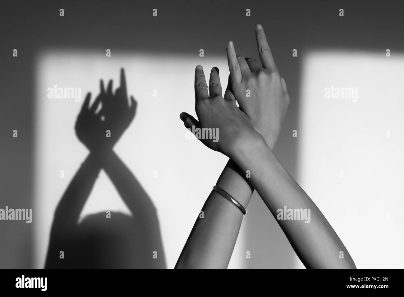 Female hands Playing with reflections in black and white - Stock Image