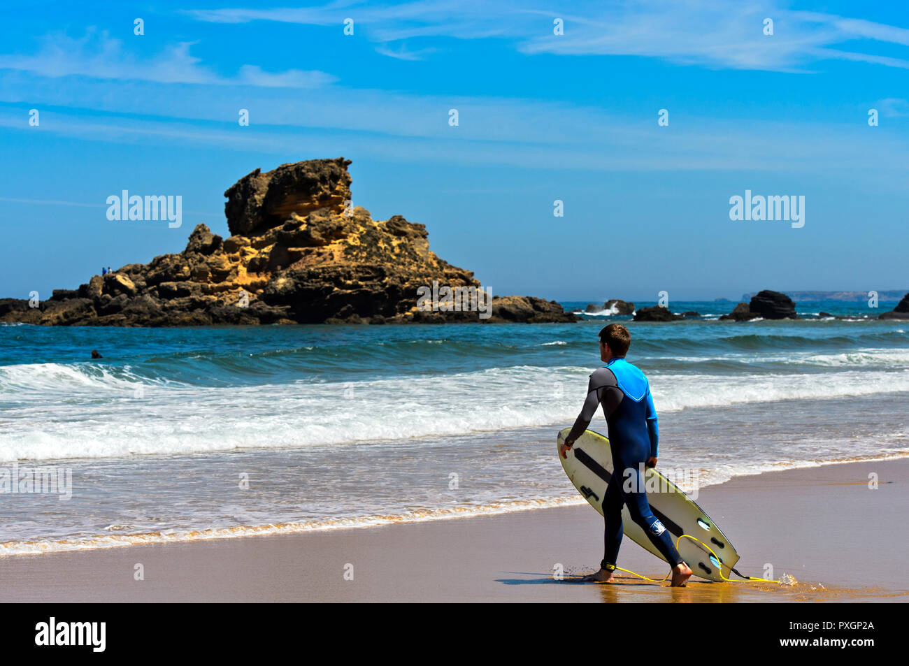 Surfer at the Praia do Castelejo beach at the Costa Vicentina coast, Vila do Bispo, Portugal Stock Photo