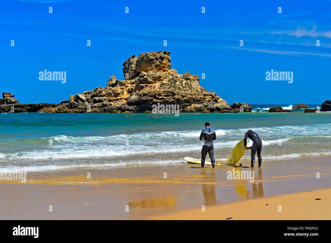 Surfer at the Praia do Castelejo beach at the Costa Vicentina coast, Vila do Bispo, Portugal Stock Photo