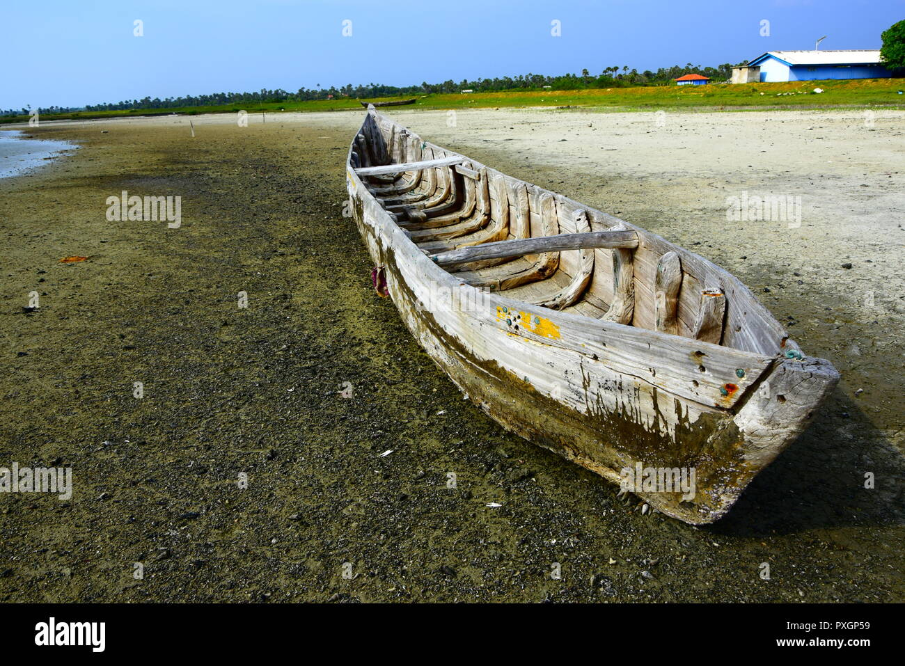 Old Fishermen Boat in a beach Stock Photo