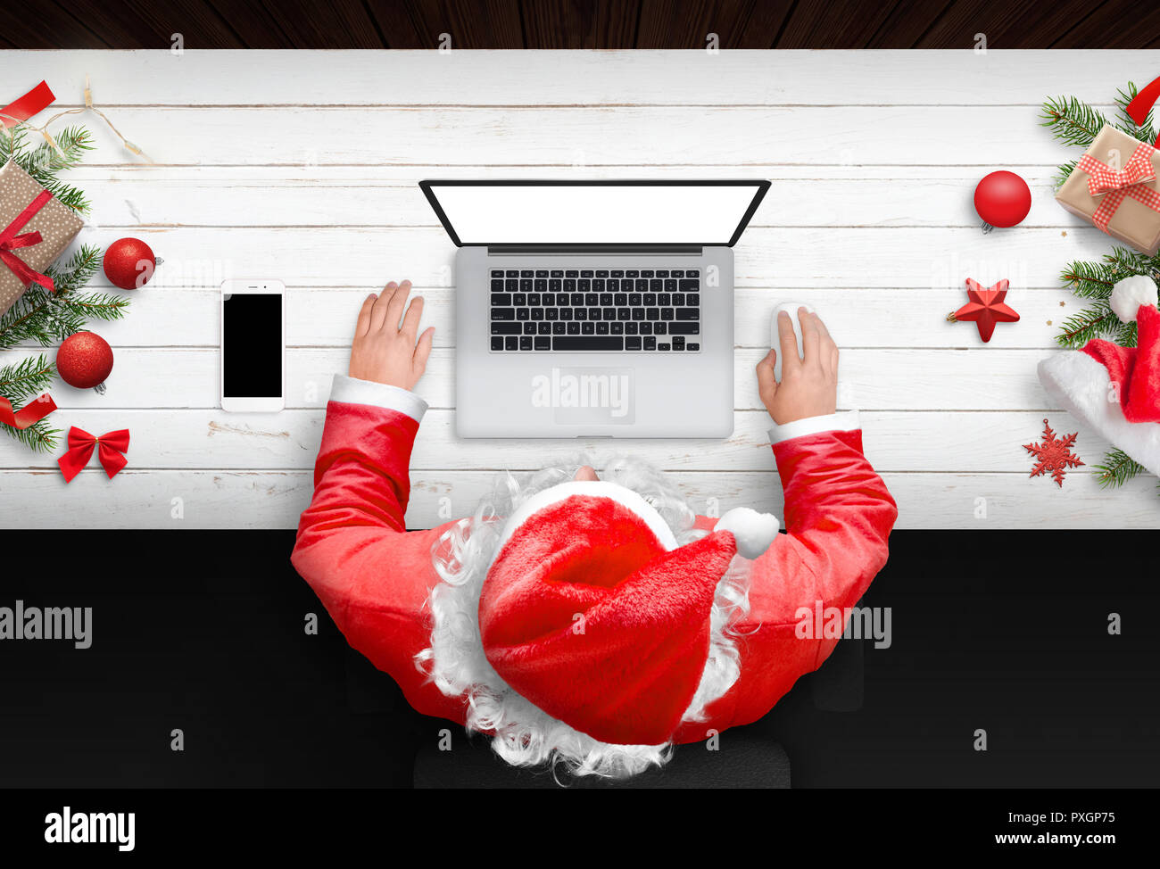 santa claus work on laptop computer with isolated screen for mockup
