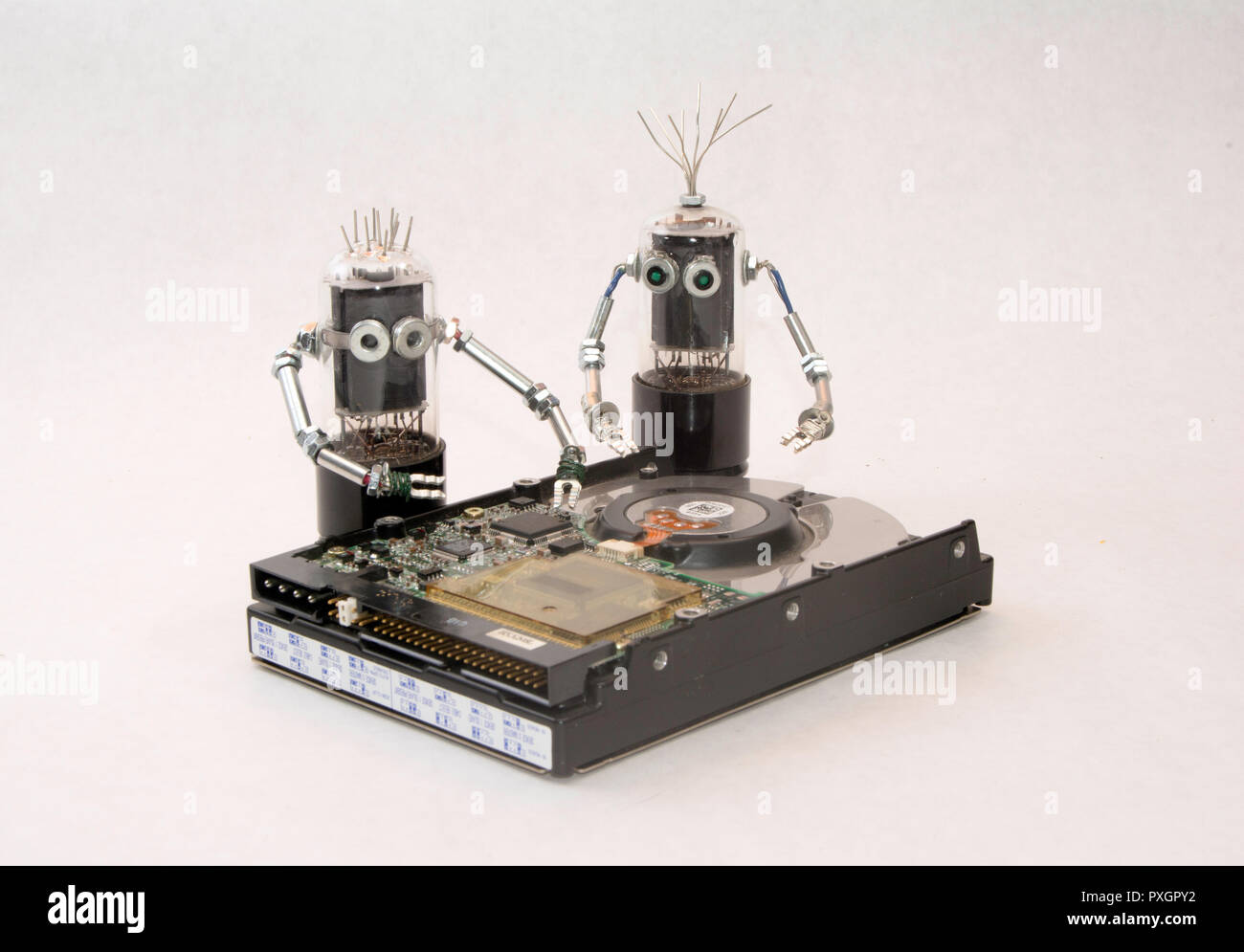 Robots repair hard drive Stock Photo