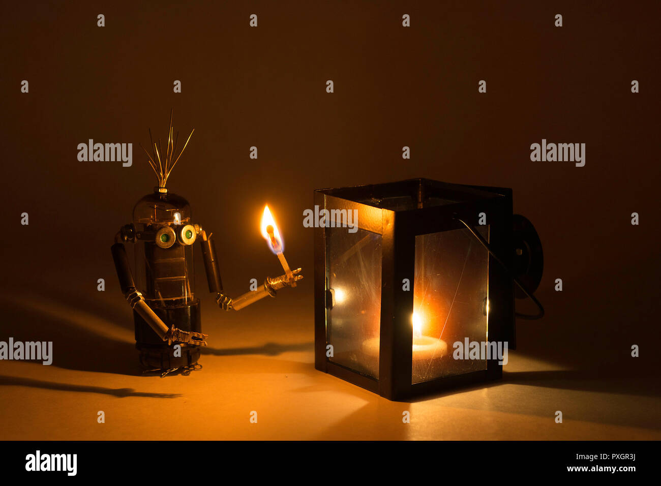 Robot  playing with fire - Stock Image