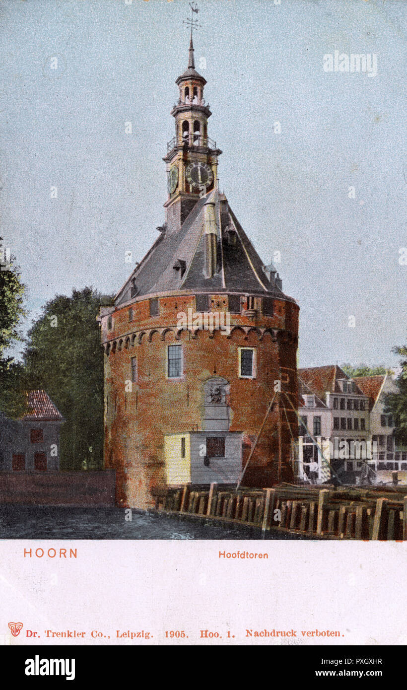 Hoorn is a town and a former Dutch East India Company base in the Dutch province of North Holland. It lies on the IJsselmeer, a lake north of Amsterdam. The harbour features the Hoofdtoren, a 16th-century tower, pictured as the focus of this card.     Date: 1905 - Stock Image