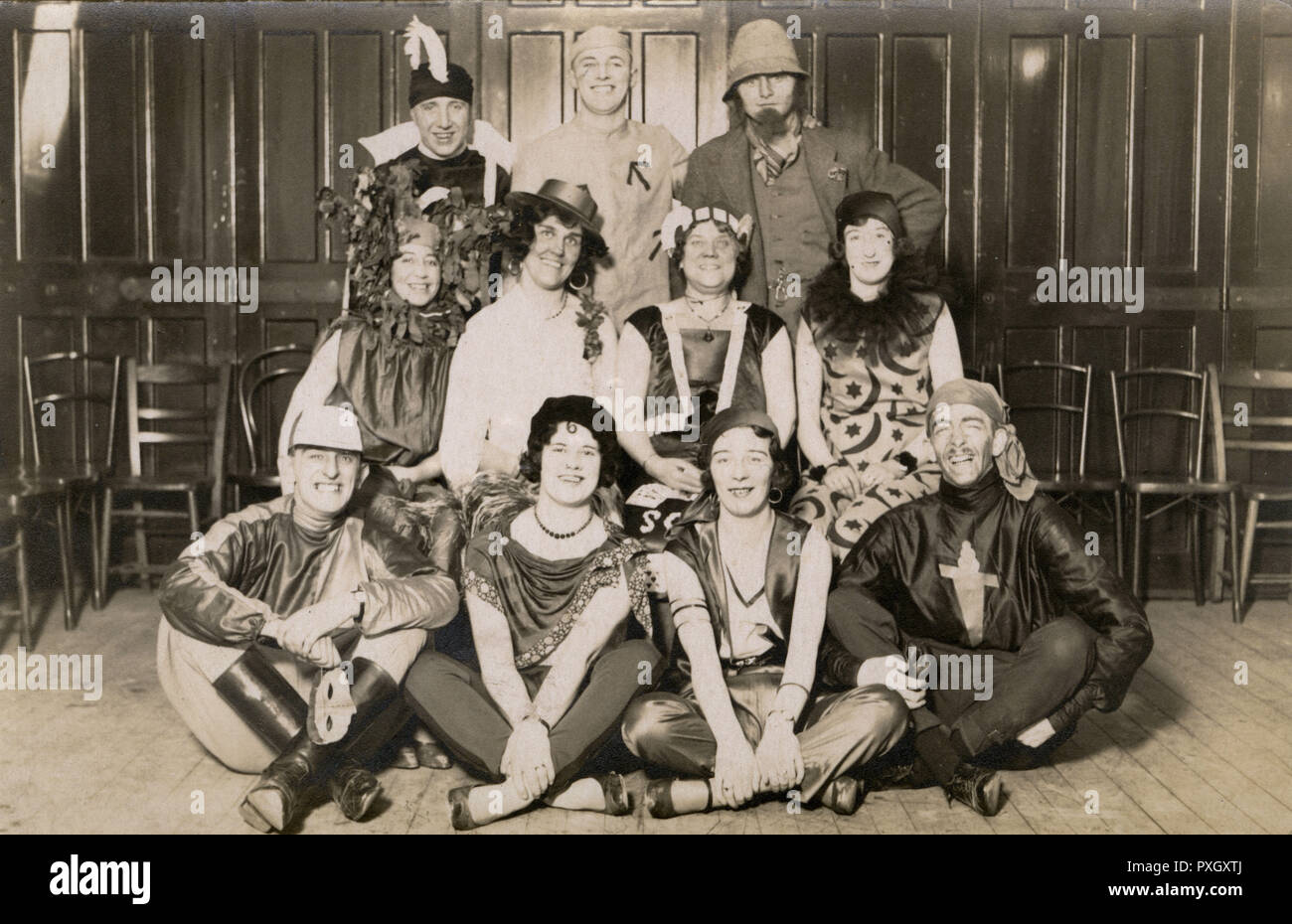 A jolly group of party revellers in various forms of fancy dress including a jockey, a gypsy (a favourite them of the 1920s) and a convict.       Date: c.1927 - Stock Image