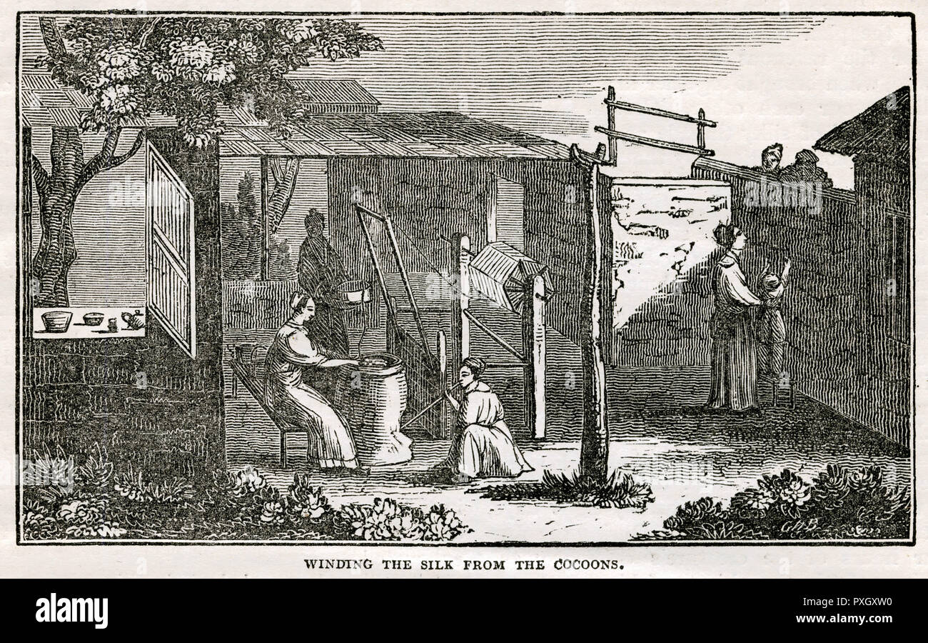 Winding off the silk into singles, but the woman appears for the moment to have left her post for the purpose of blowing the fire.      Date: 1833 - Stock Image