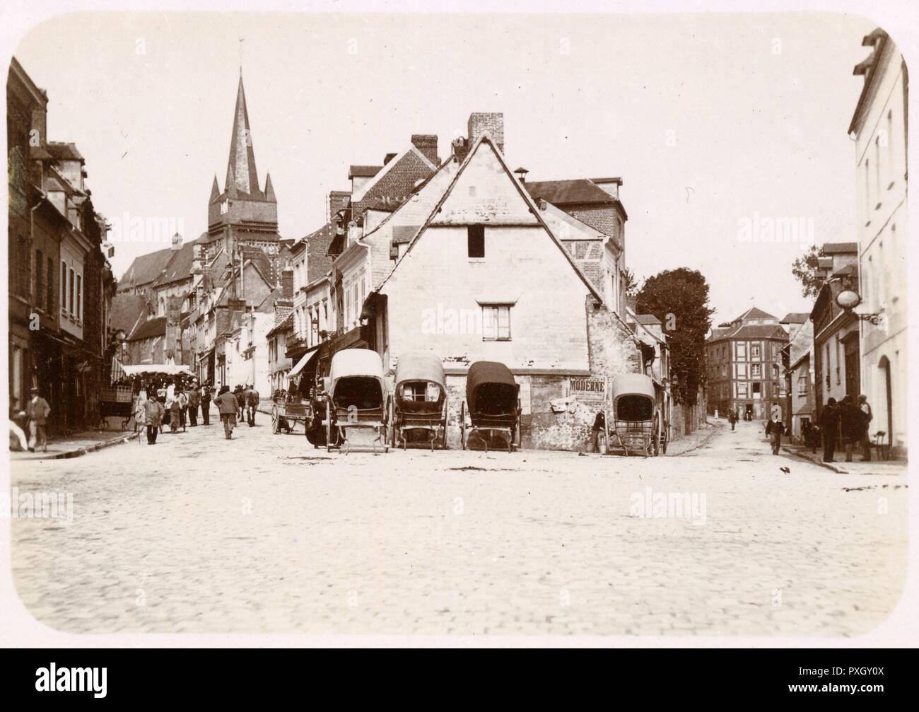 Street Scene - Neufchatel-en-Bray - a commune situated in the Seine-Maritime department of the Normandy Region, northern France.     Date: 1899 - Stock Image