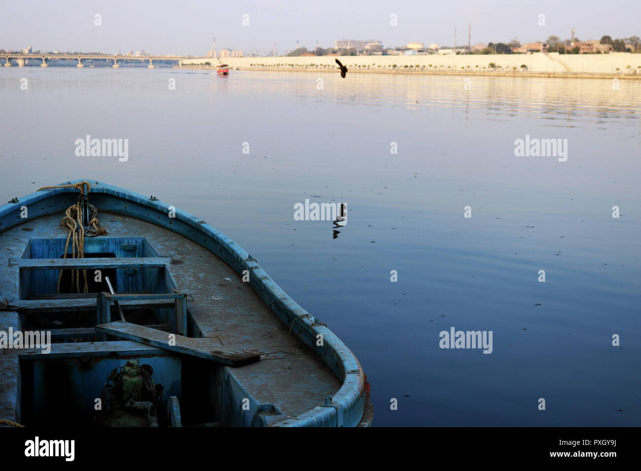 Ahmedabad river front blue boat in blue water - Stock Image