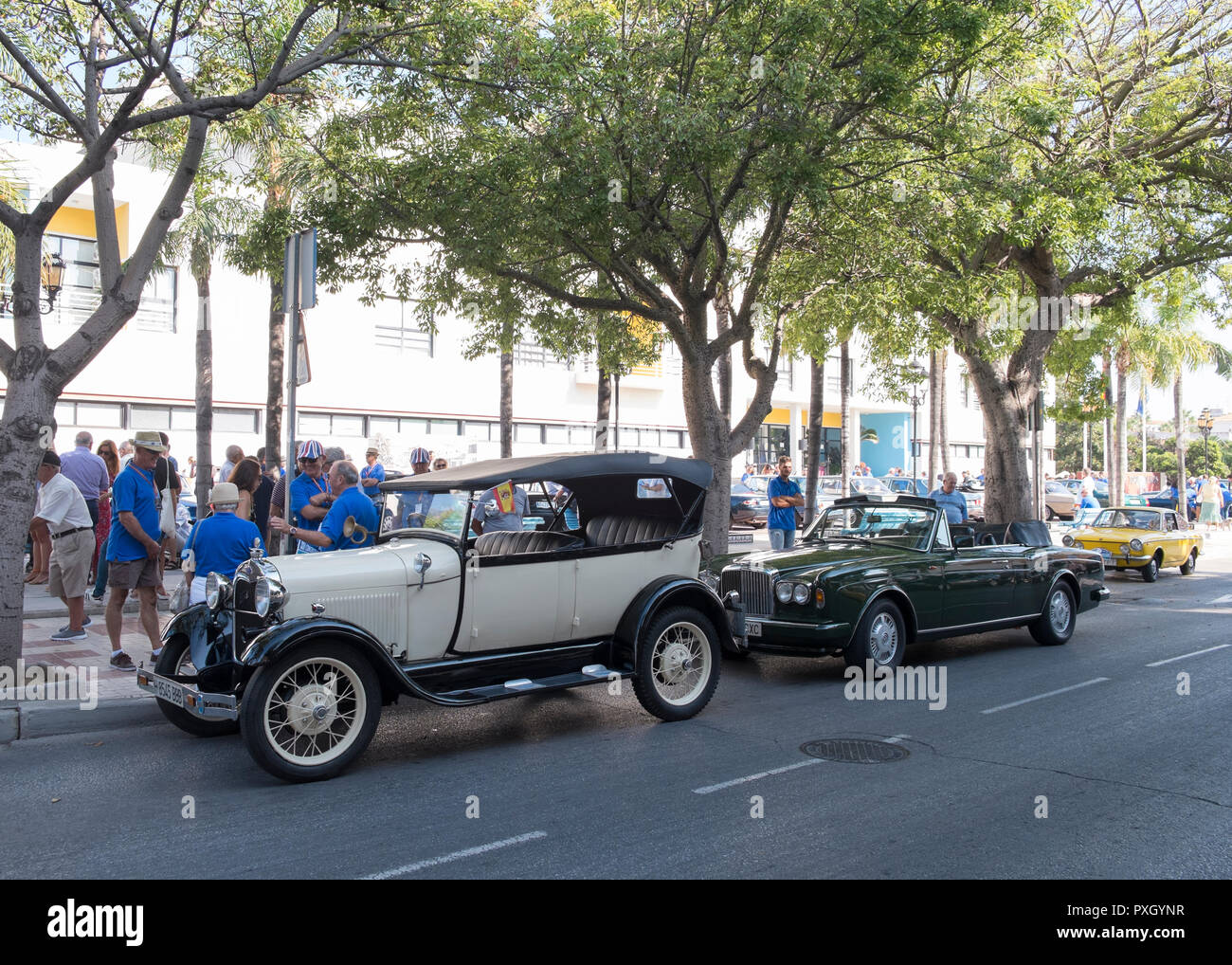 Ford A, Bentley Continental convertible and Fiat 850 sport coupé. Classic car meeting at Torremolinos, Málaga, Spain. - Stock Image