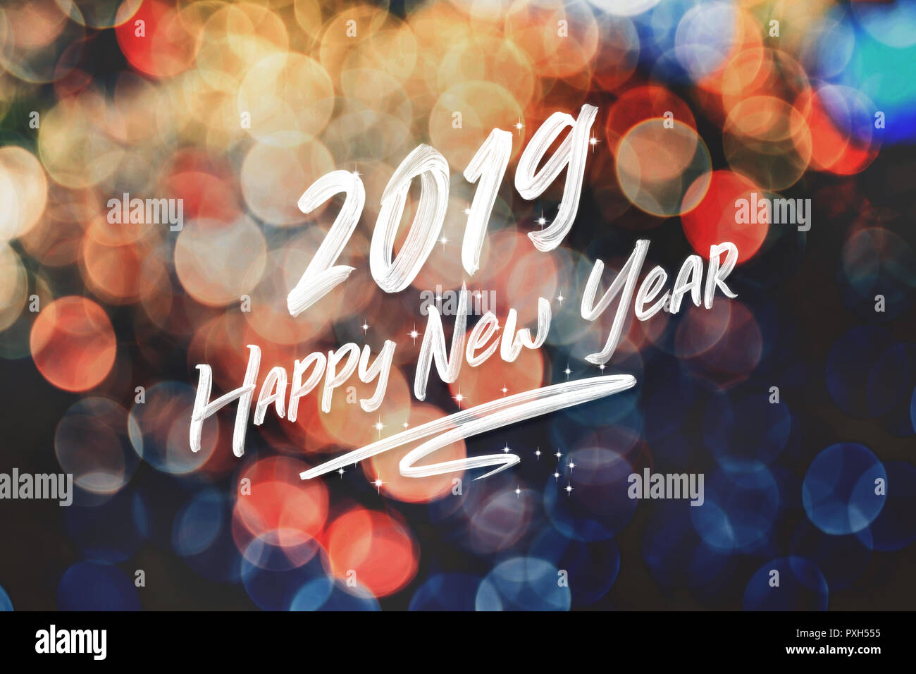 Brush stroke handwriting 2019 happy new year on abstract festive colorful bokeh light background,holiday greeting card - Stock Image
