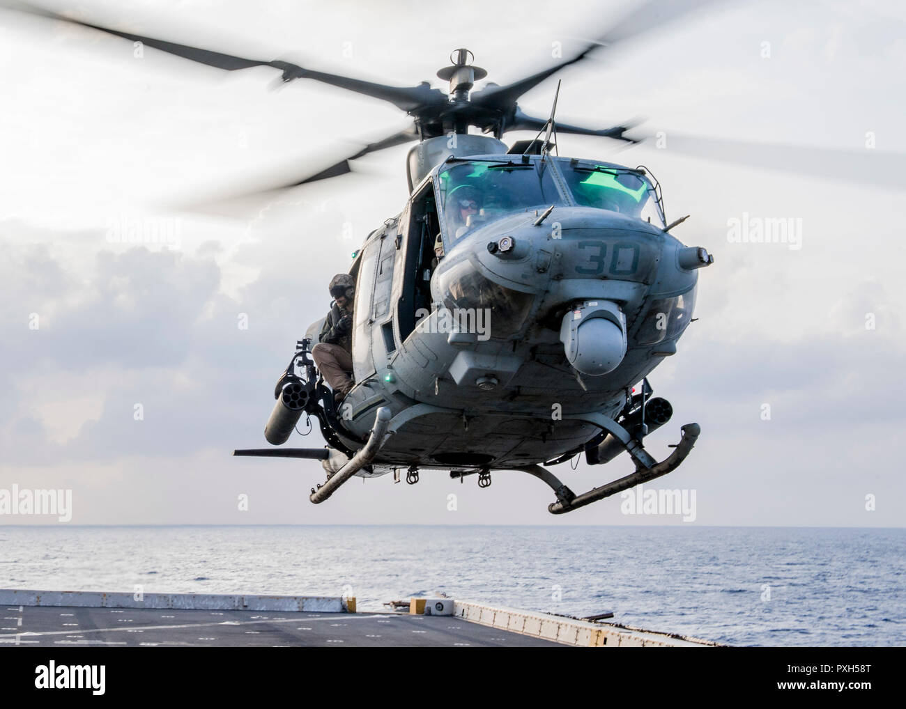 181020-N-PH222-1116 MEDITERRANEAN SEA (Oct. 20, 2018) A UH-1Y Venom helicopter, attached to Marine Medium Tiltrotor Squadron (VMM) 166 (Reinforced), conducts flight operations from the flight deck of the San Antonio-class amphibious transport dock ship USS Anchorage (LPD 23) in the Mediterranean Sea, Oct. 20, 2018. Anchorage and embarked 13th Marine Expeditionary Unit are deployed to the U.S. 6th Fleet area of operations as a crisis response force in support of regional partners as well as to promote U.S. national security interests in Europe and Africa. (U.S. Navy photo by Mass Communication  - Stock Image
