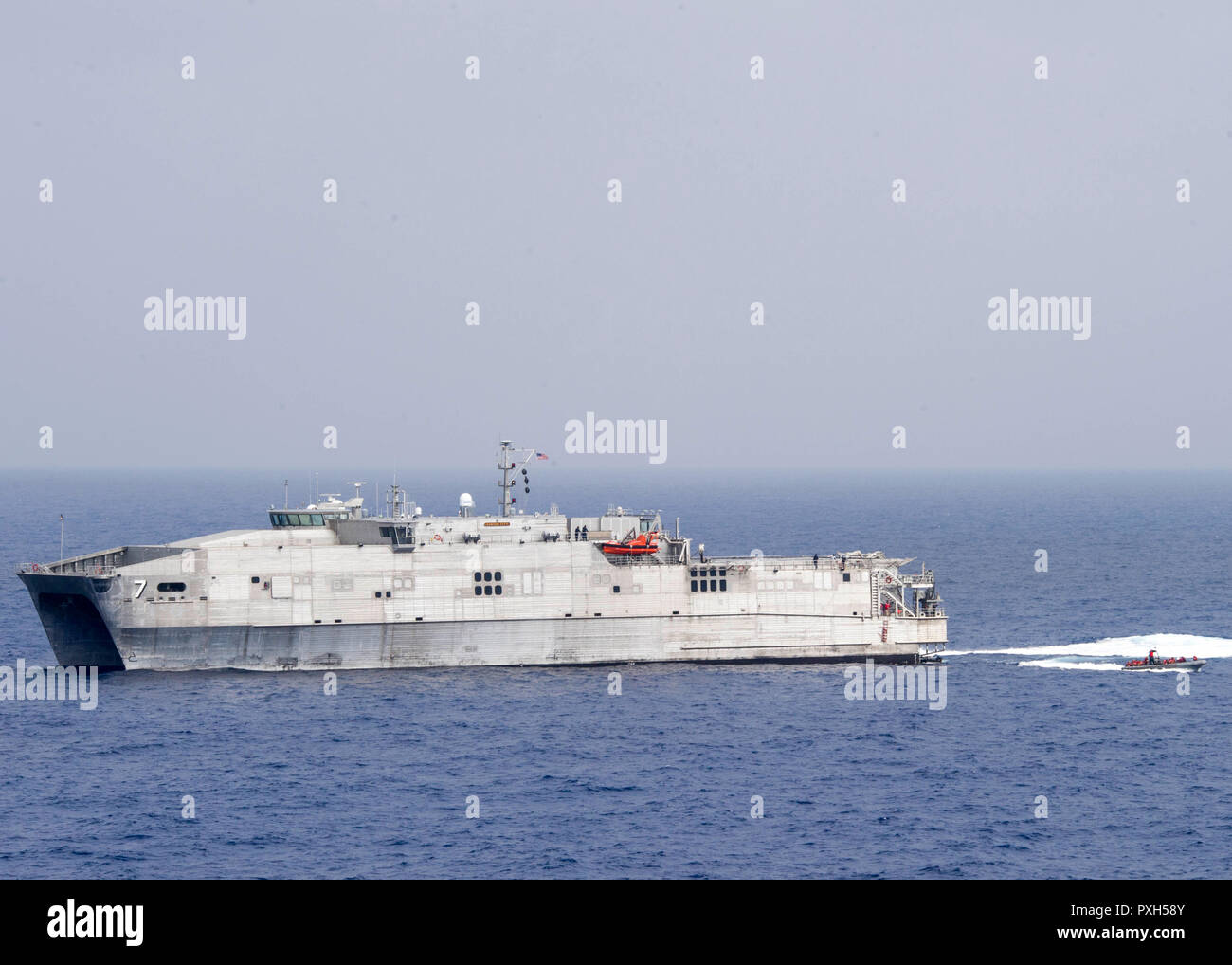 181020-N-PH222-1771 MEDITERRANEAN SEA (Oct. 20, 2018) The Spearhead-class expeditionary fast transport ship USNS Carson City (T-EPF-7) conducts small boat operations with a rigid hull inflatable boat from the San Antonio-class amphibious transport dock ship USS Anchorage (LPD 23) in the Mediterranean Sea, Oct. 20, 2018. Anchorage and embarked 13th Marine Expeditionary Unit are deployed to the U.S. 6th Fleet area of operations as a crisis response force in support of regional partners as well as to promote U.S. national security interests in Europe and Africa. (U.S. Navy photo by Mass Communica - Stock Image