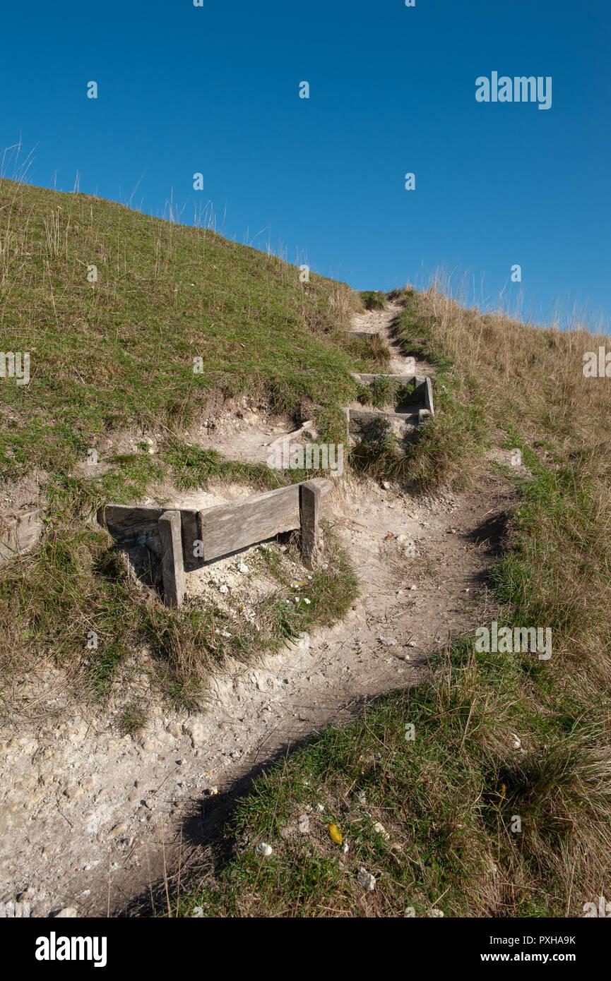 Steps cut into chalk grassland at Bratton Camp, Westbury, Wiltshire, UK. - Stock Image