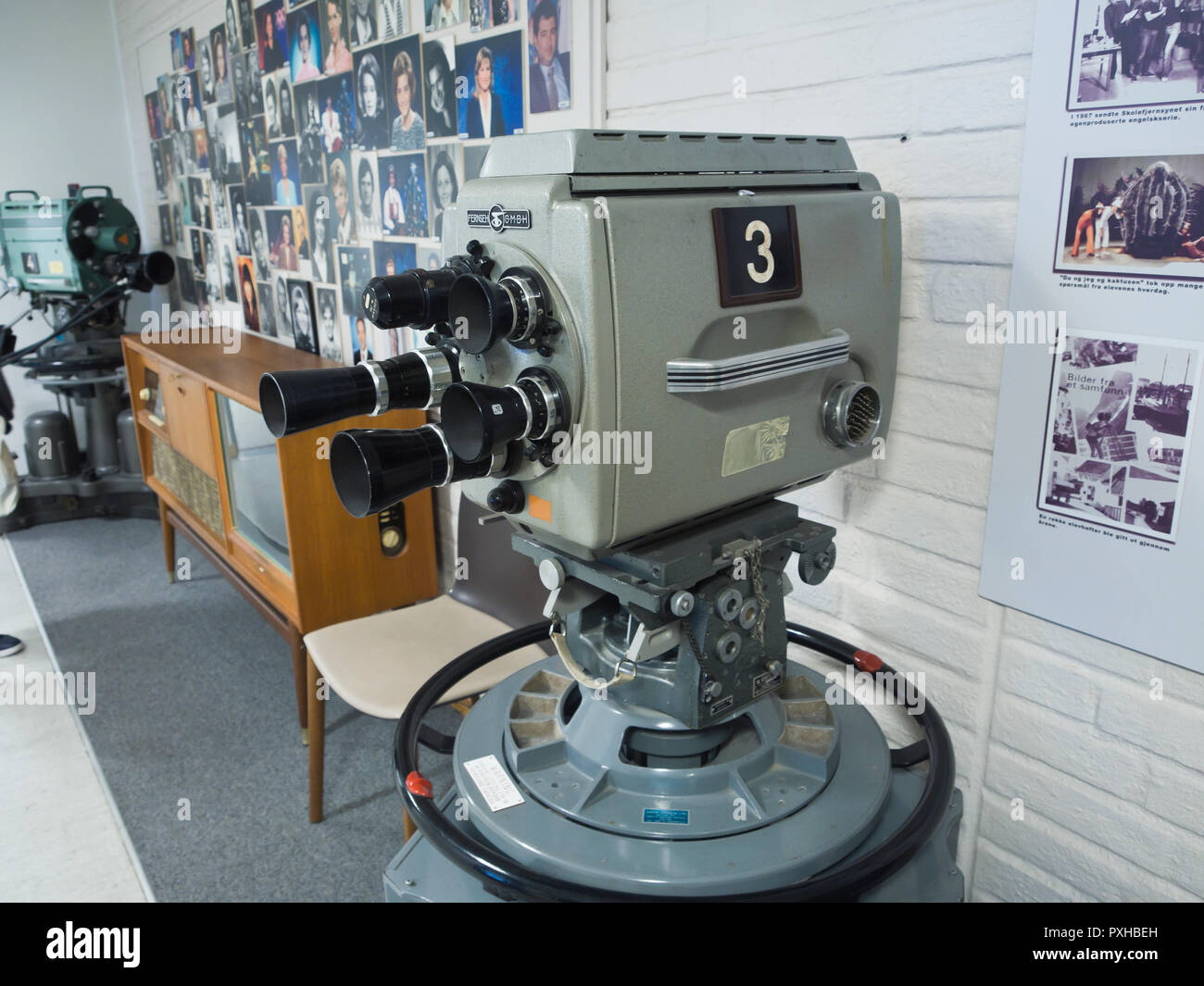 Old TV camera and historical photos in the collection of the NRK Norwegian Broadcasting Corporation in Oslo Norway - Stock Image