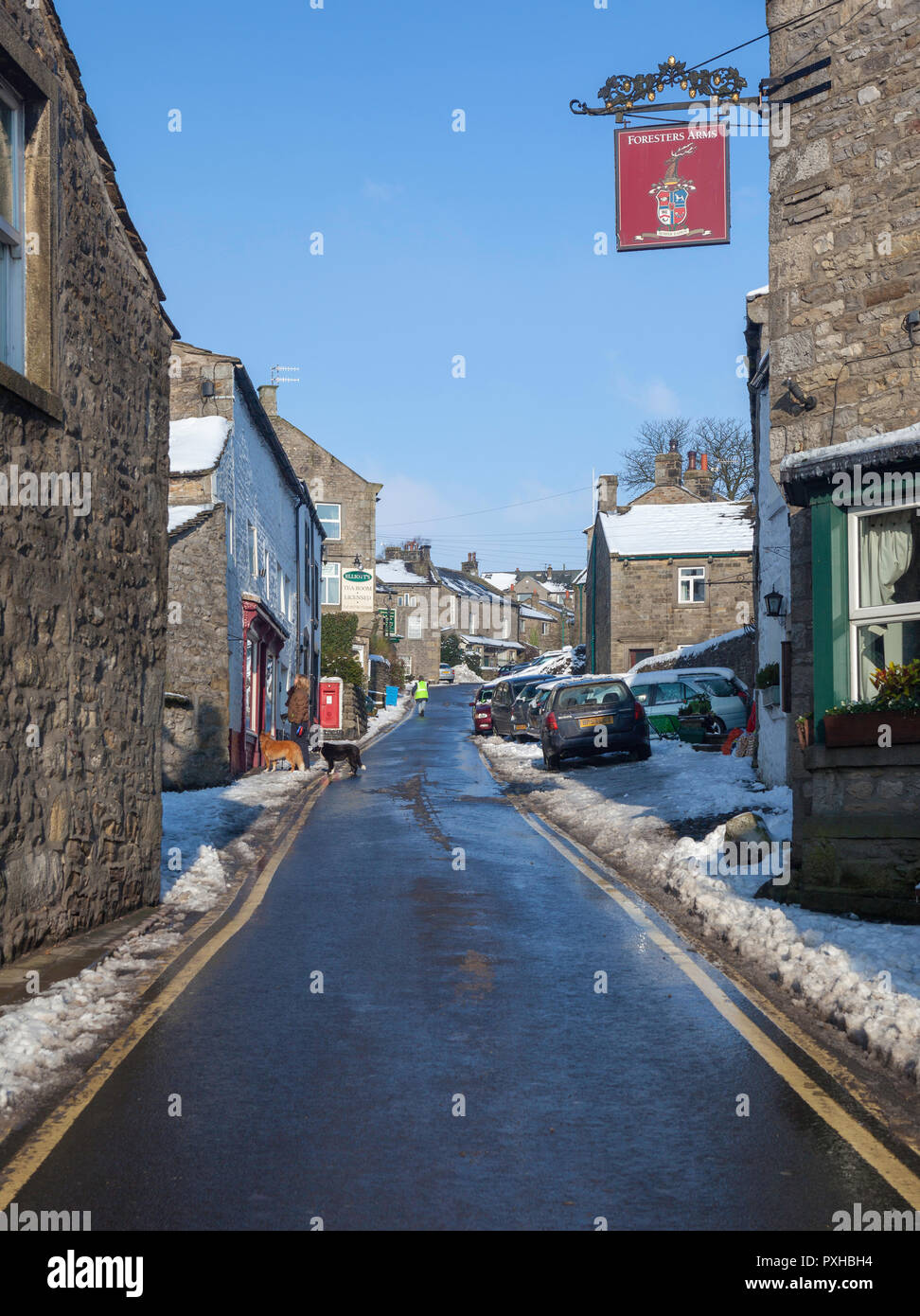 Winter view of Main Street in Grassington, North Yorkshire after snow Stock Photo