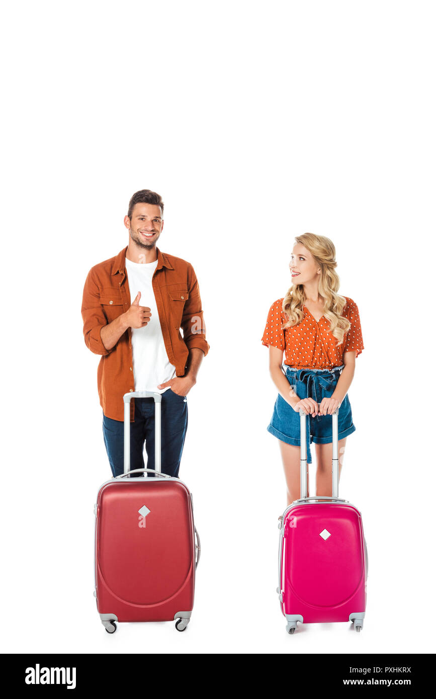 happy young couple with suitcases isolated on white - Stock Image