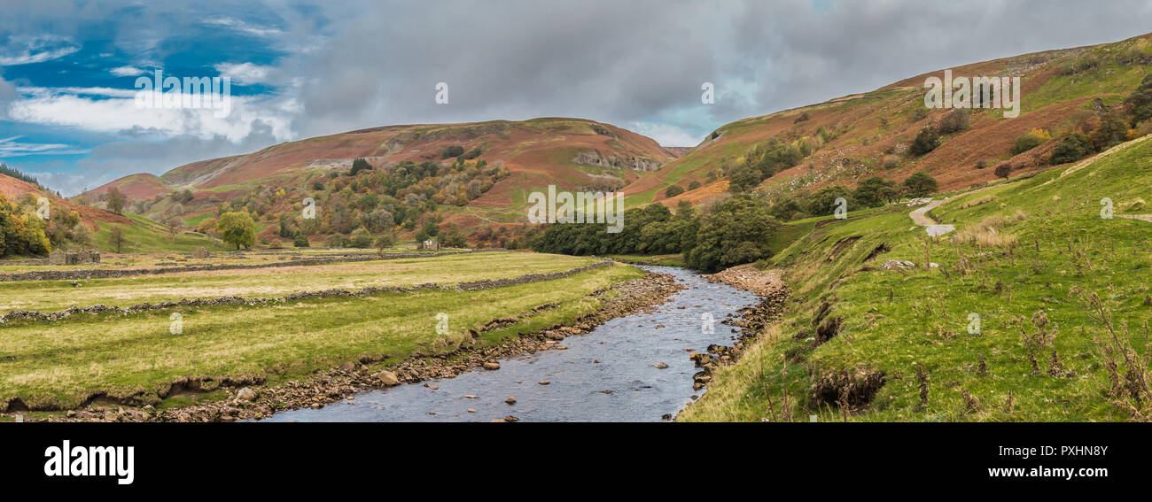 Yorkshire Dales National Park panoramic autumn landscape, the River Swale looking upstream towards Keld on the Coast to Coast long distance footpath,  - Stock Image