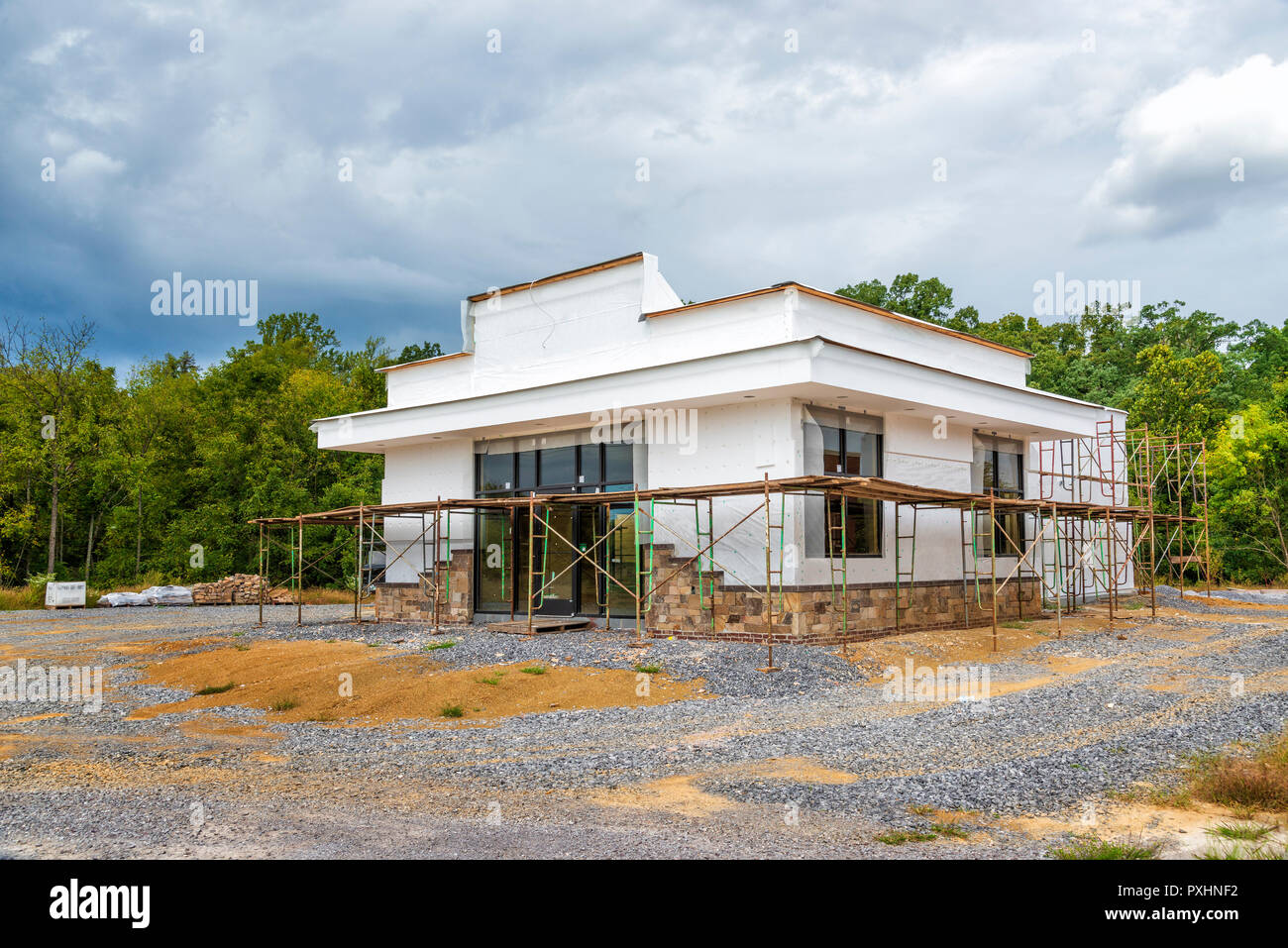 Horizontal shot at an angle of a fast food restaurant under construction.  All visible markings and signs have been removed. Stock Photo